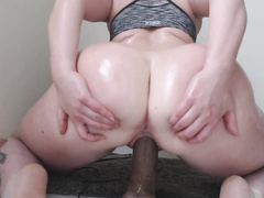 Big oiled ass riding black dildo