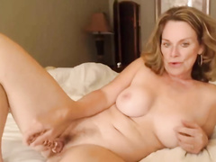 Superb MILF toys her trimmed pussy